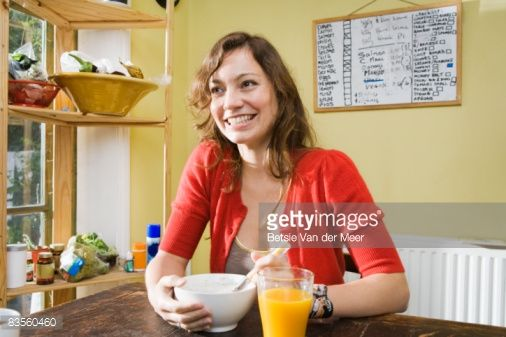 Stockfoto : Woman having breakfast.