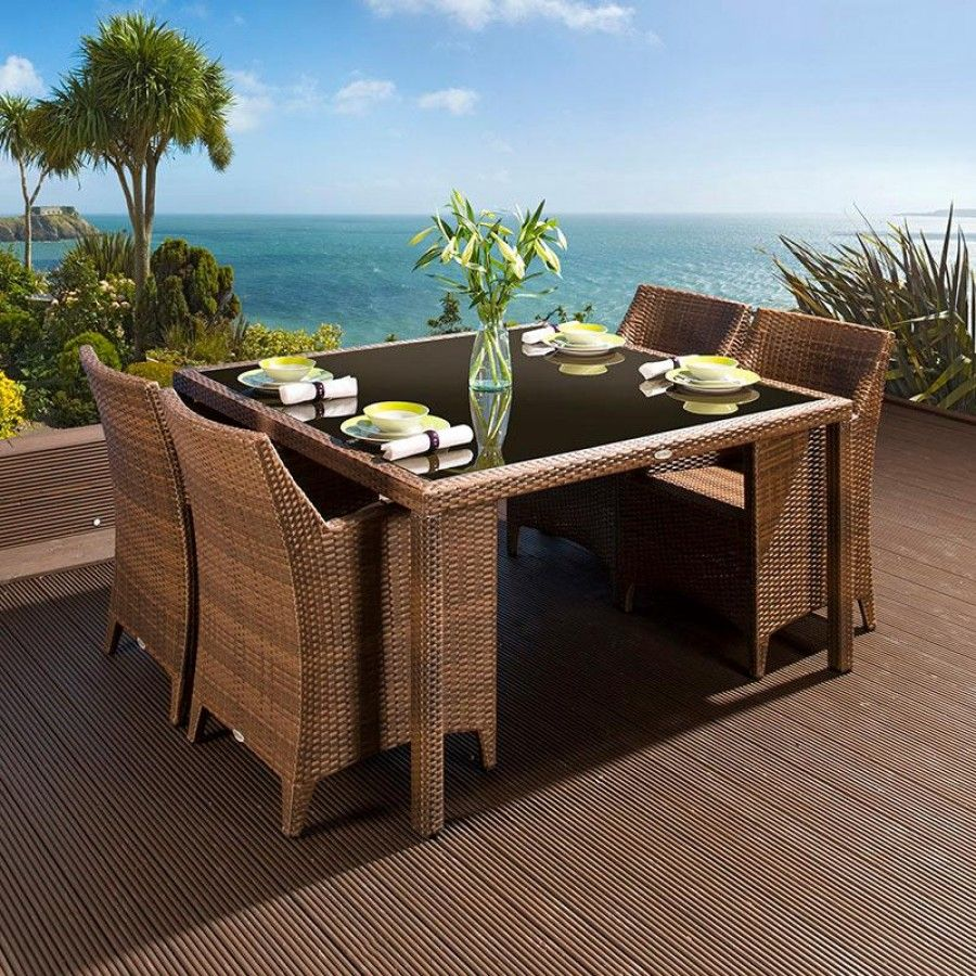 The dining set consists of a square dark brown glass topped table ...