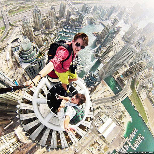 Alexander Remnev and friend on top of the Princess Tower, Dubai - fresh world map building in dubai