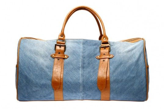 duffel bag is made from old denim jeans and reworked leather coats designed & made by Miranda Chance; the perfect combination of the durability & softness of denim & leather.