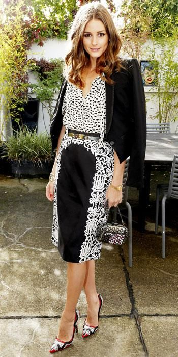 The style-setter dined at a Montblanc lunch in a black and white ensemble, including a printed blouse and leather pumps.