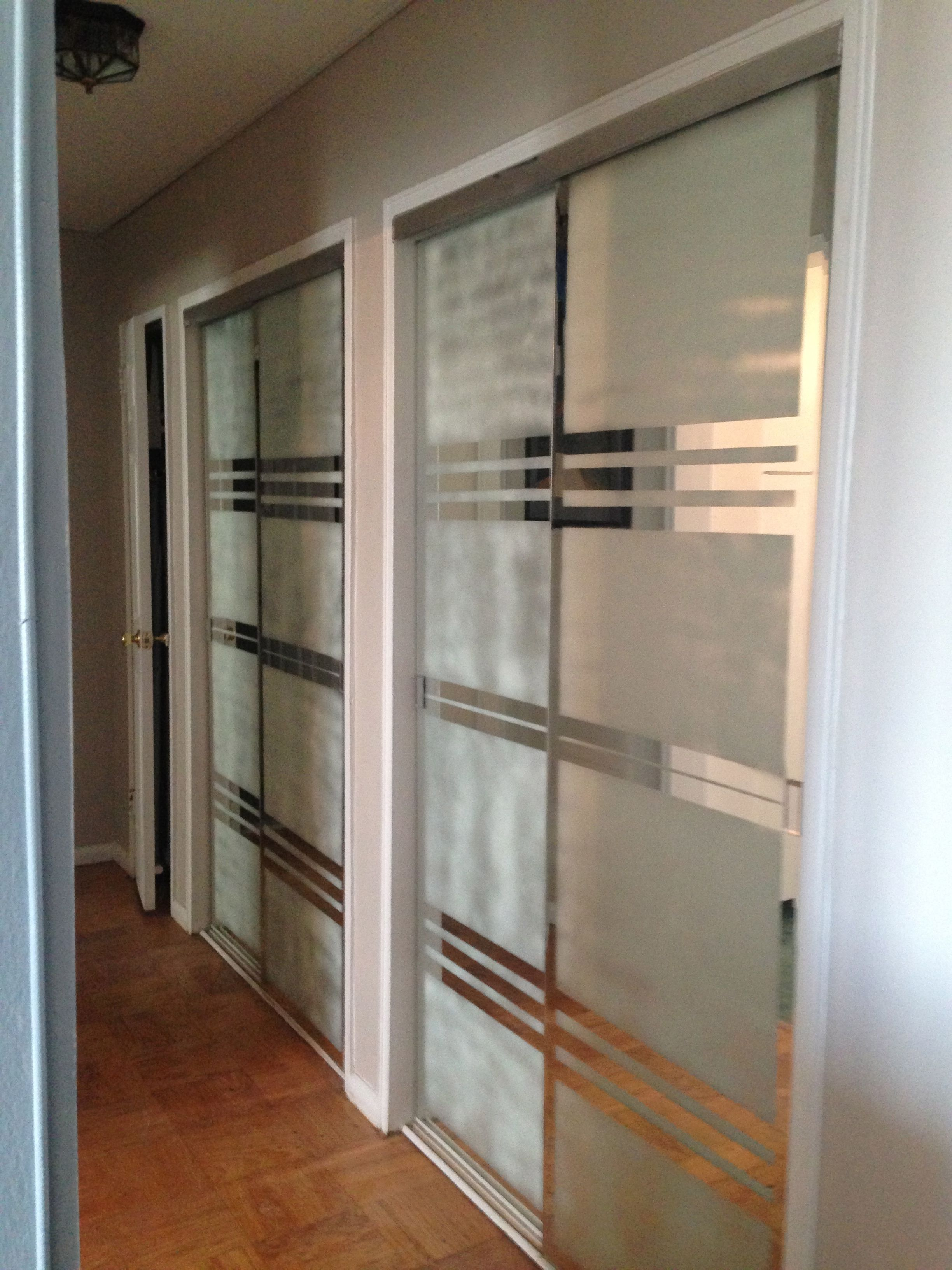 used blue tape and frosted spray to create more modern design on mirror closet doors in