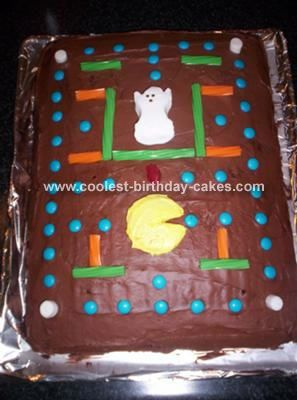 Pacman Cake: First I made just a rectangle cake for this Pacman cake. To decorate it I made a cupcake and cut off the top for Pacman. Then I got colored Twizzlers for