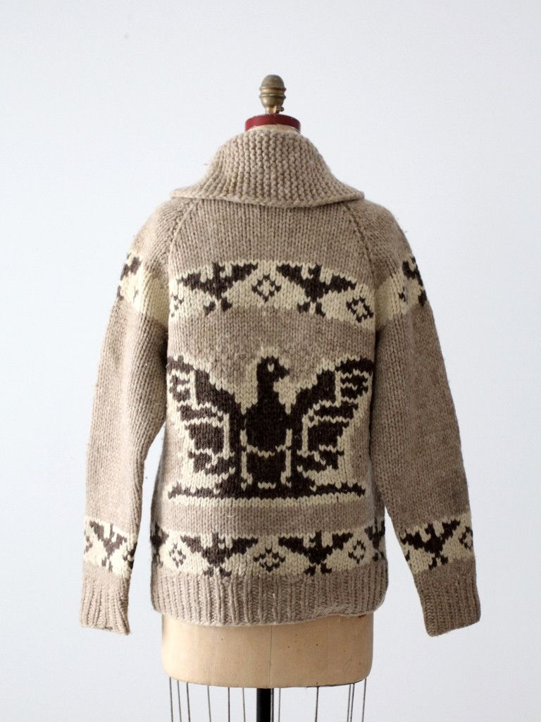 35e7f2d9c7a A vintage hand-knit cowichan sweater. The thick wool sweater features a  thunderbird eagle pattern in natural wool tones and a zipper closure.