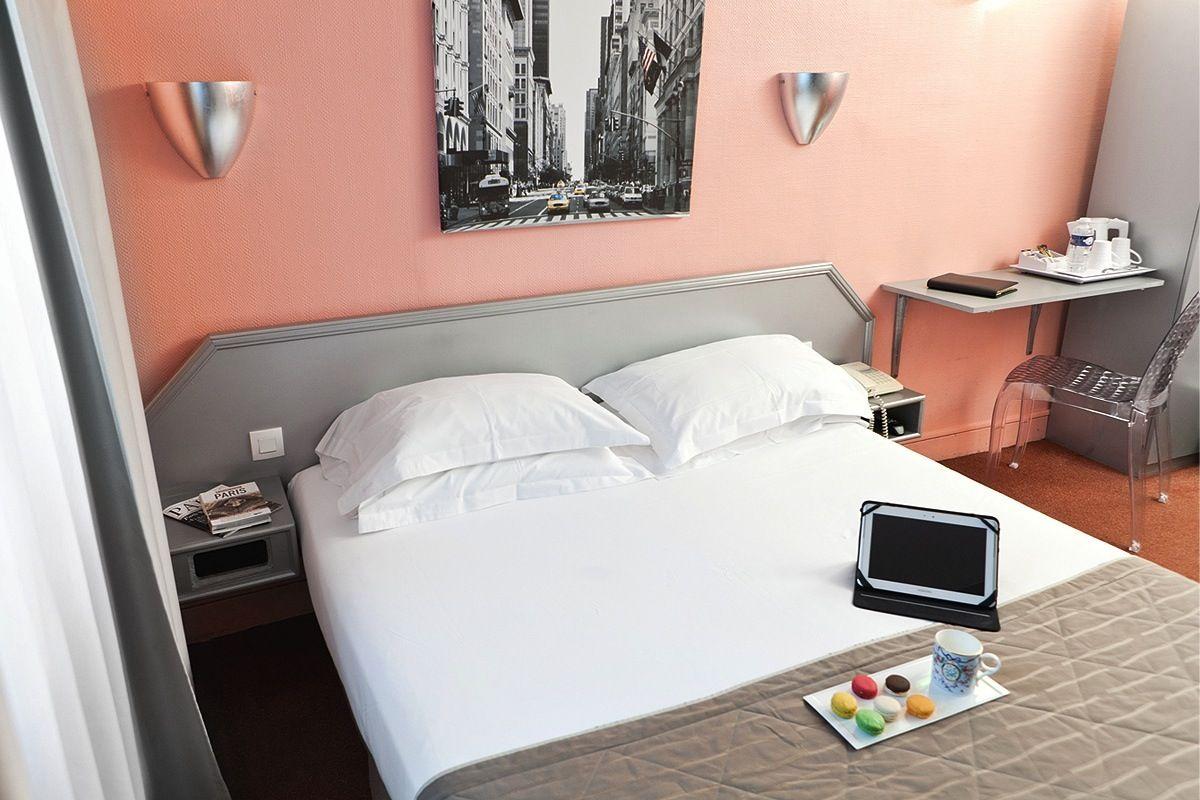 Coral pink bedroom at the Hôtel Jean Gabriel Montmartre in Paris
