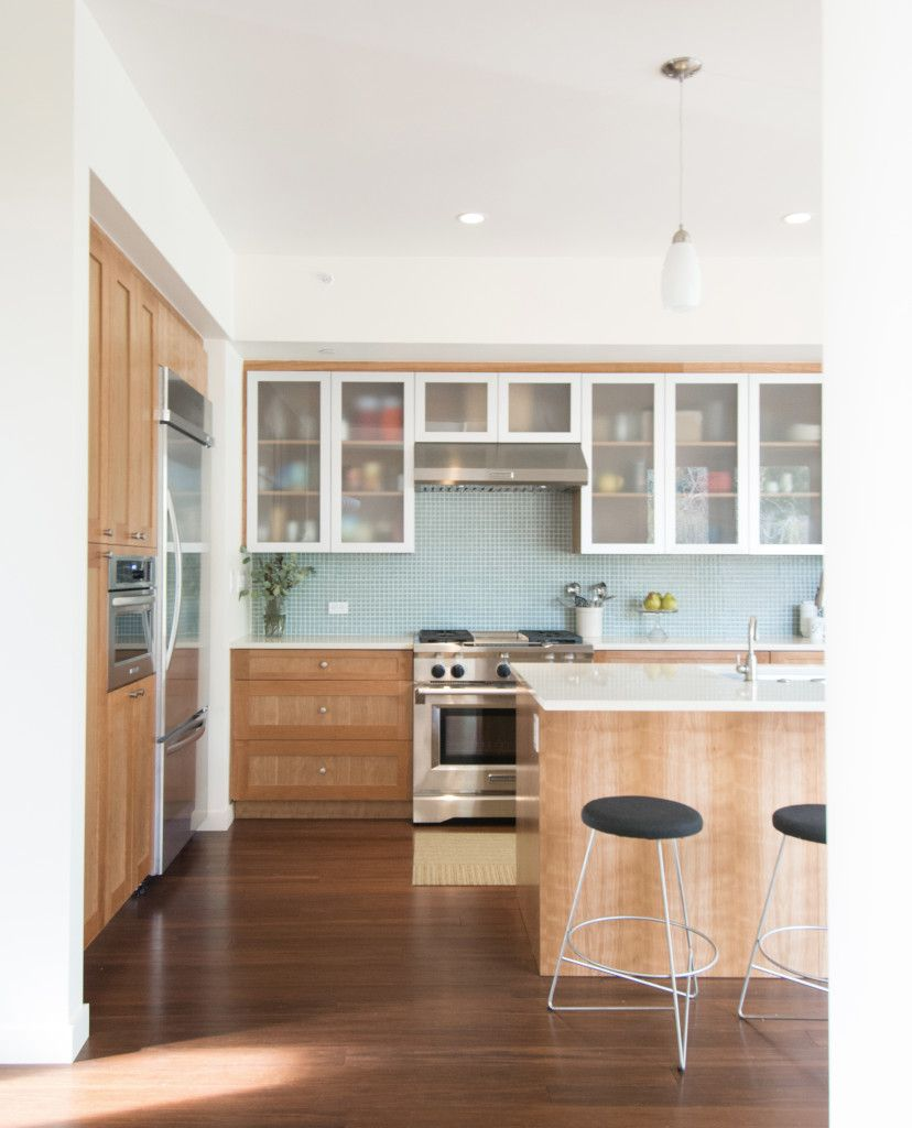 I like the frosted cabinets with the brushed trim on the ...