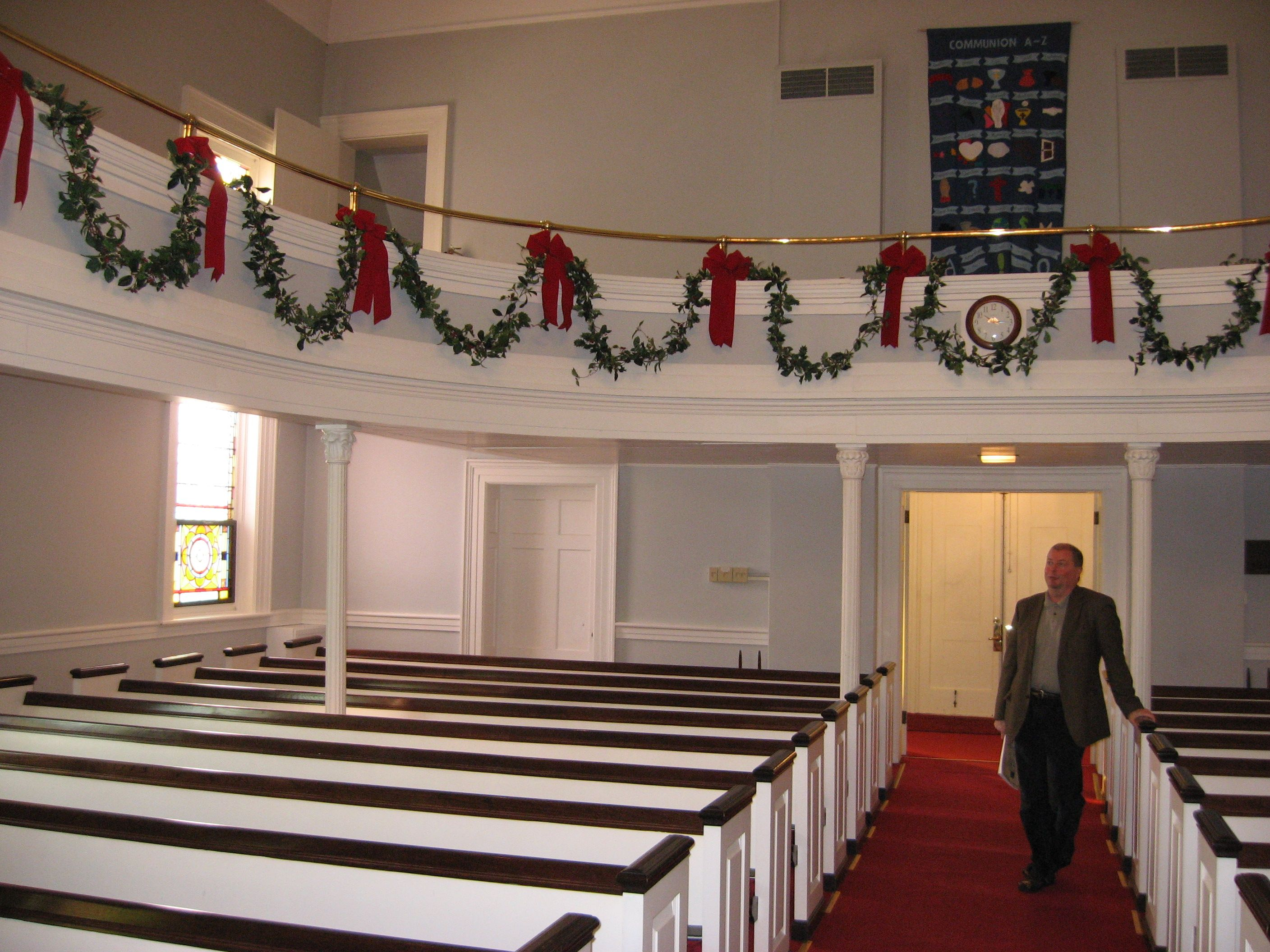 pastor scott deblock checks out the christmas decorations recently put up in the sanctuary of the niskayuna reformed church