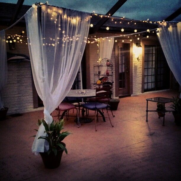 DIY: 4x 10ft pvc and 4x 7ft pvc. I put the legs in the potted plants...strung lights and pit sheer curtains on the 10ft pvc pipes. TURNED OUT AWESOME!    I redid my Mom's patio. Been wanting to do a canopy for a while, so I did!     Photo by alexisunderwoodarts on Instagram