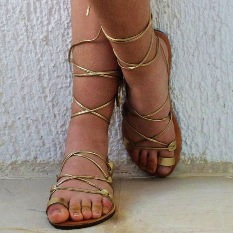 ba8ce835bfe Golden Cross Strap Toe Ring Flat Gladiator Sandals in 2019