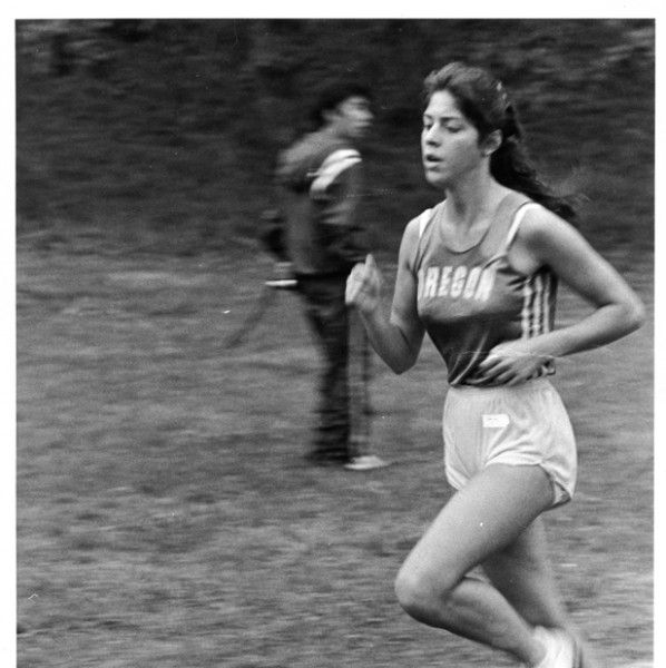 Black and white photo of an unidentified University of Oregon cross country runner taken during a race in 1980. ©University of Oregon Libraries - Special Collections and University Archives