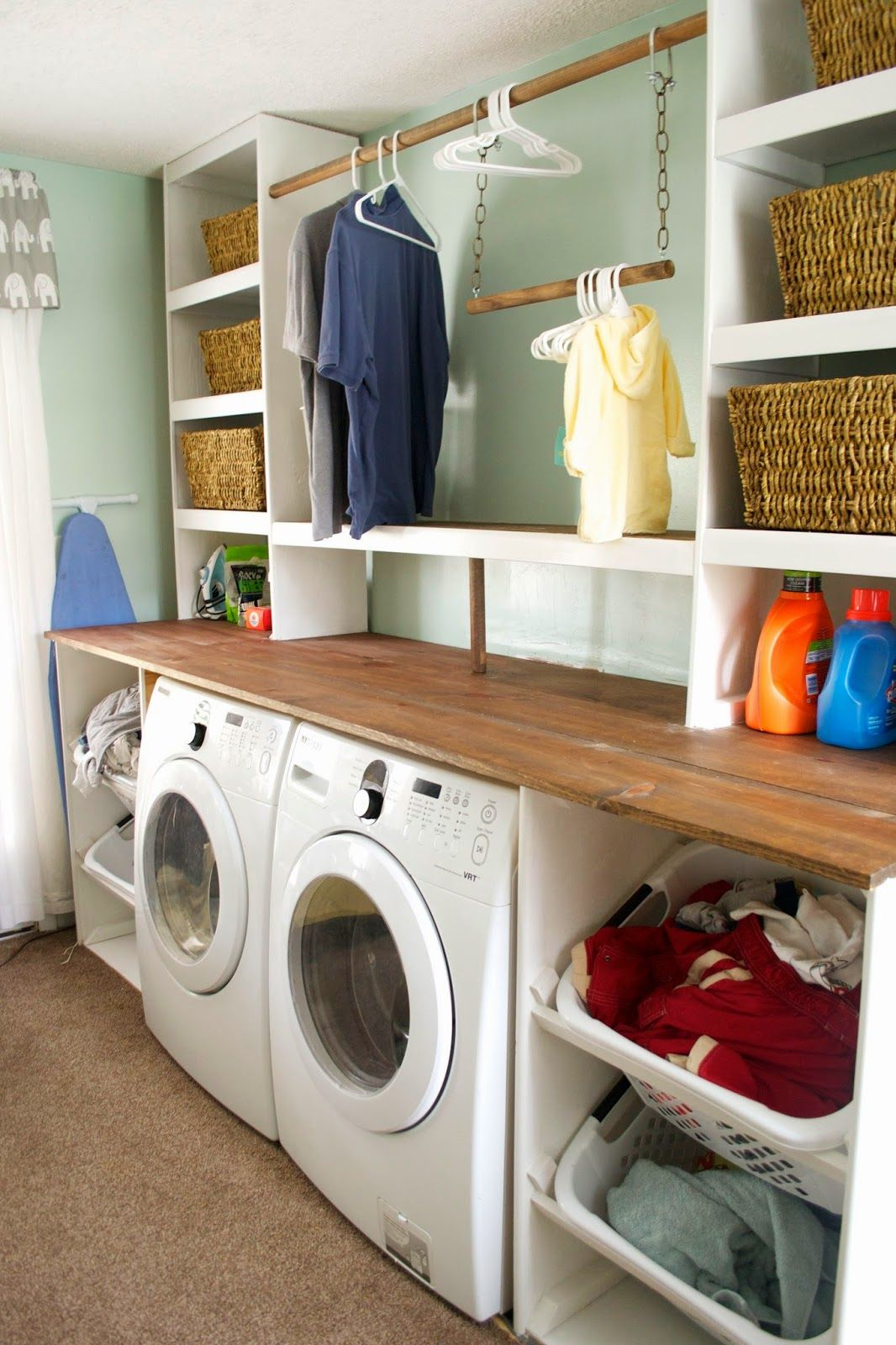 Built-in Laundry Unit with Shelving, Seesaws and Sawhorses on Remodelaholic.com #setinstains