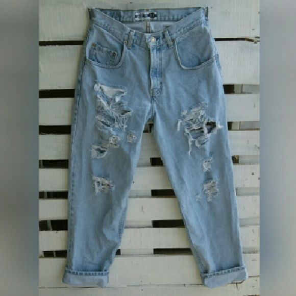 "Baggy distressed boyfriend jeans Gap denim men's baggy fit. Super distressed and has a rip on the back upper thigh. Light wash denim. 100% cotton. 29"" waste.  Measurements: Waste 29"" Inseam 32"" Hip 42"" Rise 11"" GAP Jeans Boyfriend"