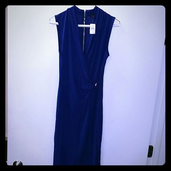 """Ann Taylor Matte Jersey Wrap Dress This is a size small, Ann Taylor Matte Jersey Wrap dress in Blue Depths, it is a gorgeous deep royal blue shade with gold fixtures for the """"belt"""" and zipper along the back. Never worn, with tags on. It is originally a 109.00 dress. Ann Taylor Dresses"""