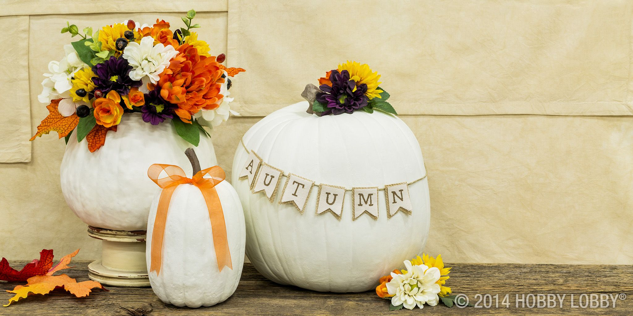 Dress up a pretty pumpkin with fall flowers and homemade pennant - Hobby Lobby Halloween Decorations