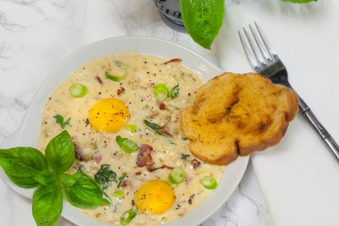 Photo of Baked Eggs in Tasso Cream is a French with Cajun smoked meat flavor.