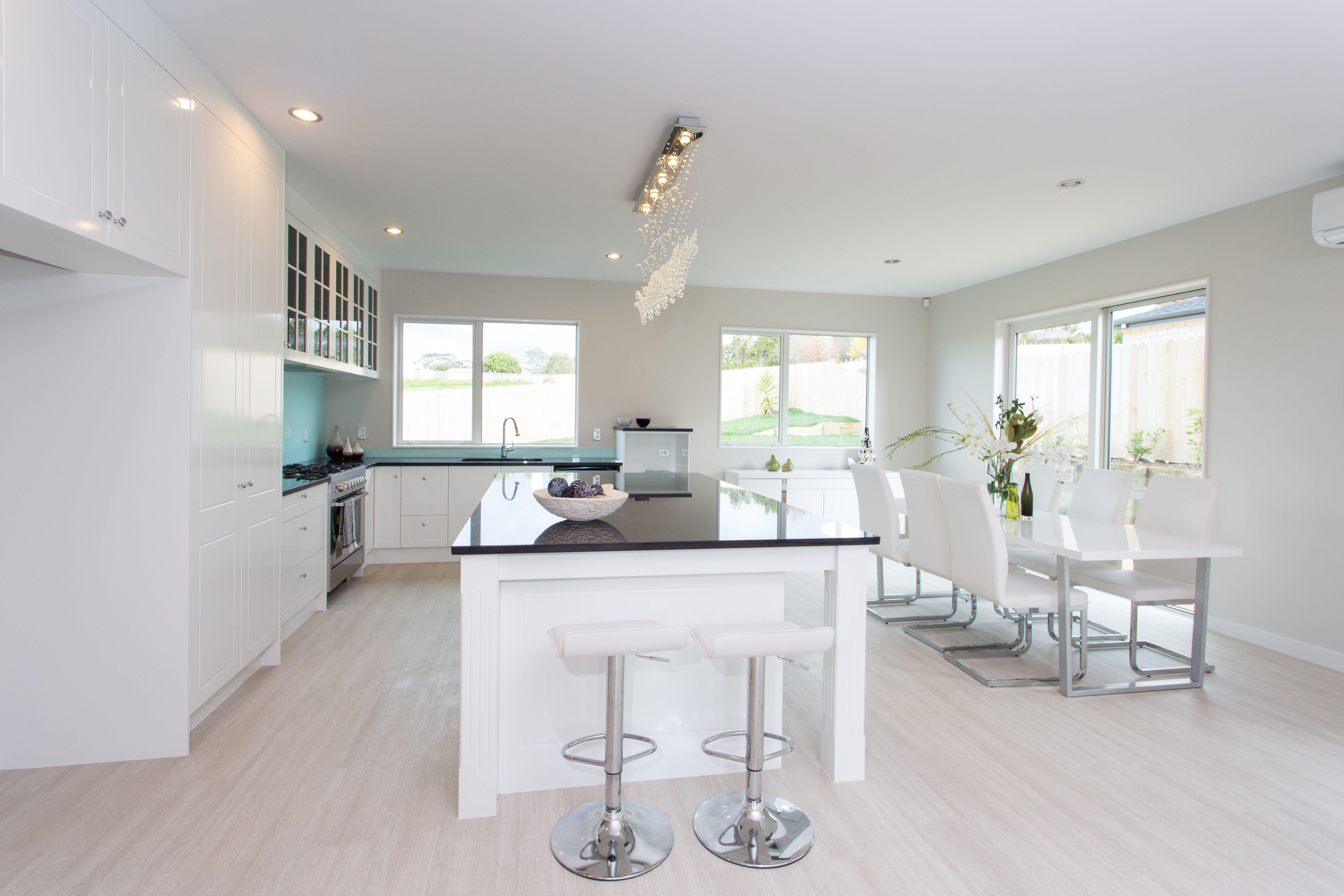 white pine flooring with glossy white kitchen so