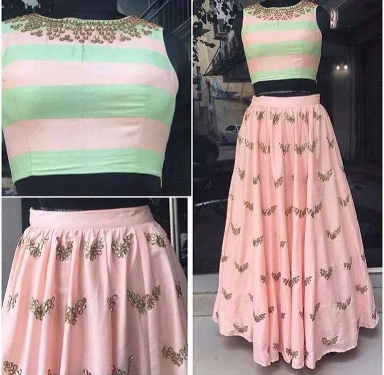 a041d588285f5 Pink designer skirt with crop top. The fabric used is georgette. We will  contcat you to get the measurements.