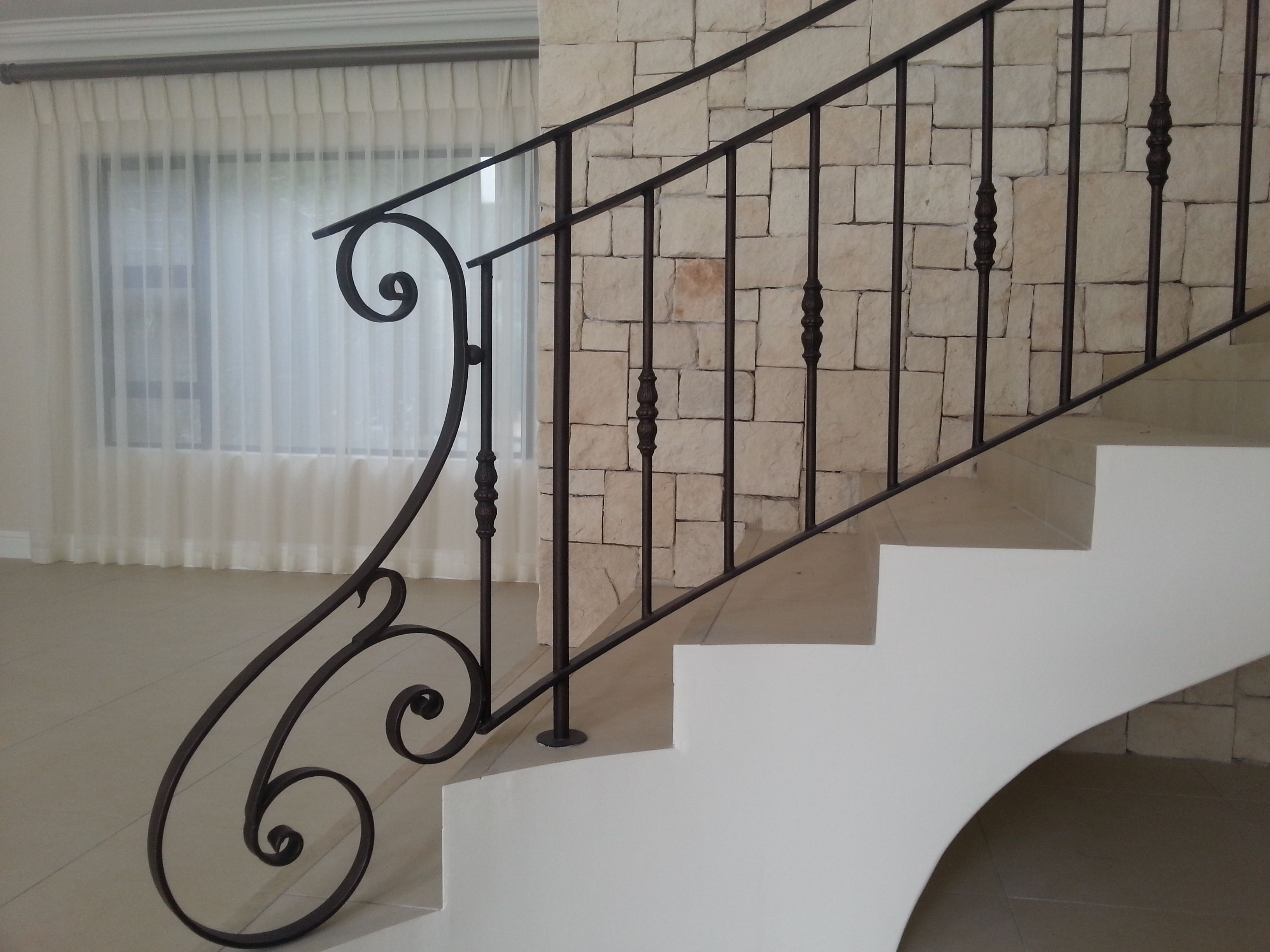 Wrought iron balustrades end scroll