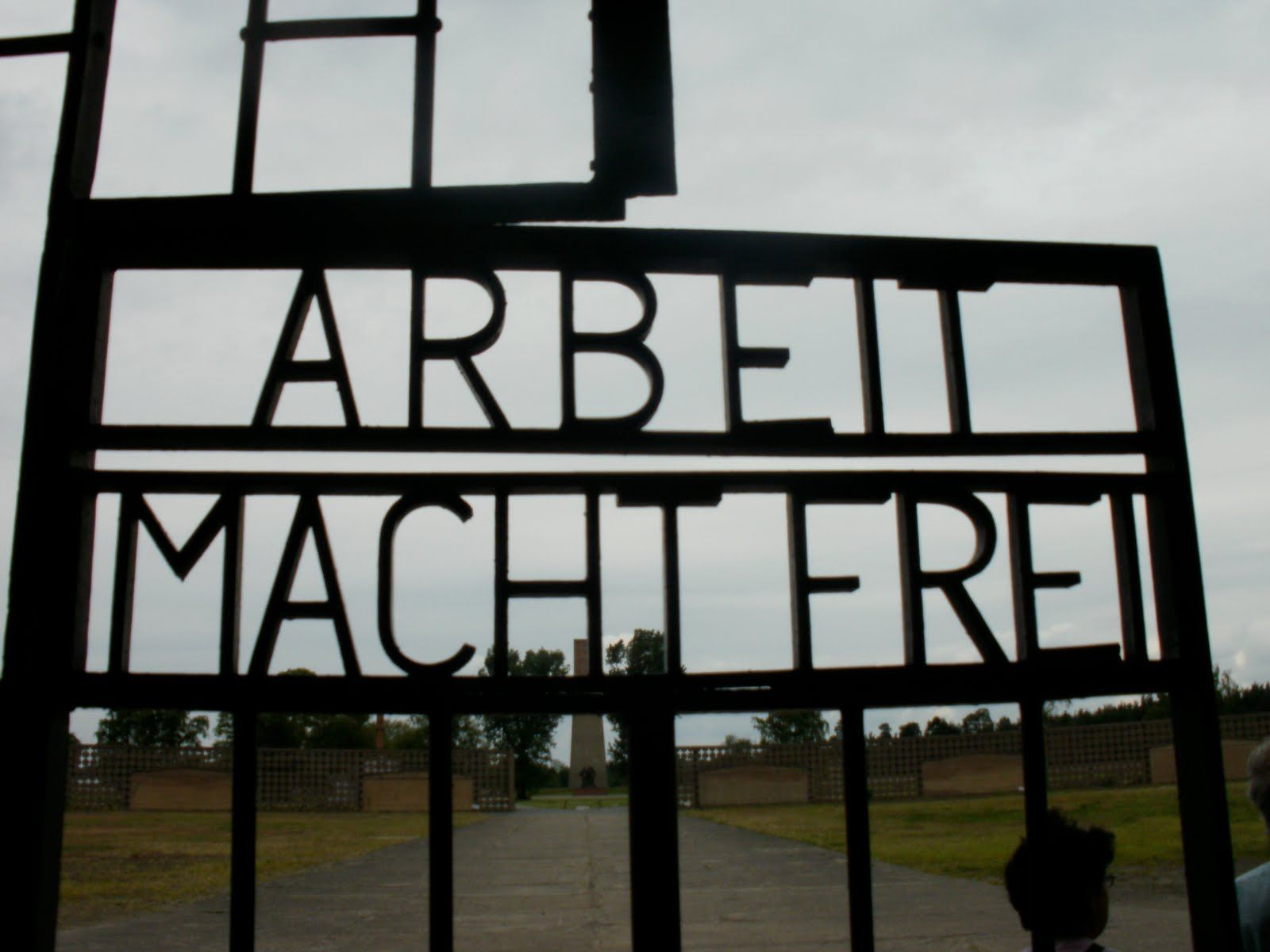 """Sign over entrance to Nazi Extermination Camp Auschwitz-Birkenau (Poland): """"Wok makes you free"""" - an attempt to convince the arriving Jews, despite operating crematoria, palls of smoke, & stench of burning humans, that they were at a Labor Camp"""