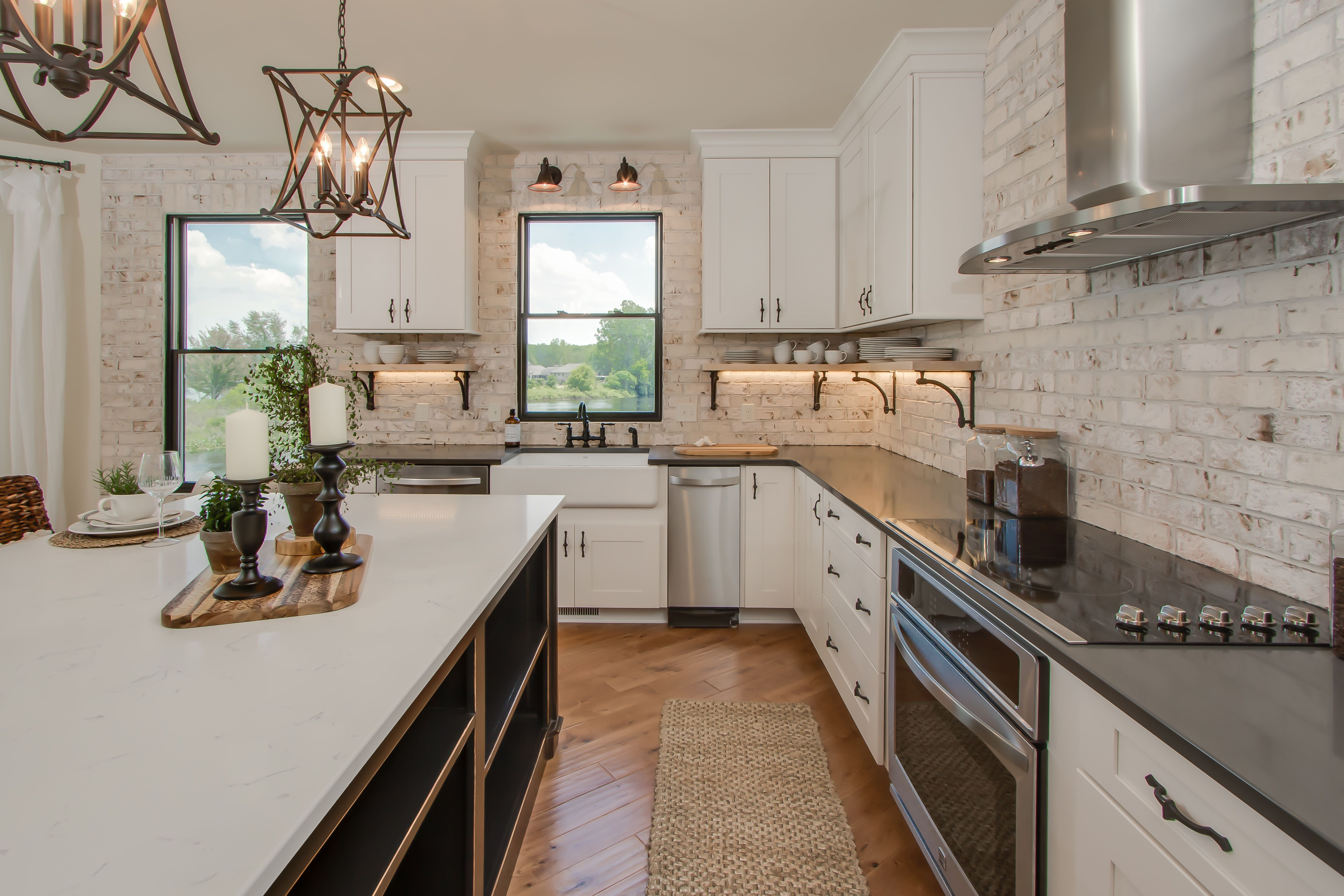 Kitchen: brick accent wall, painted cabinets, granite counters ...