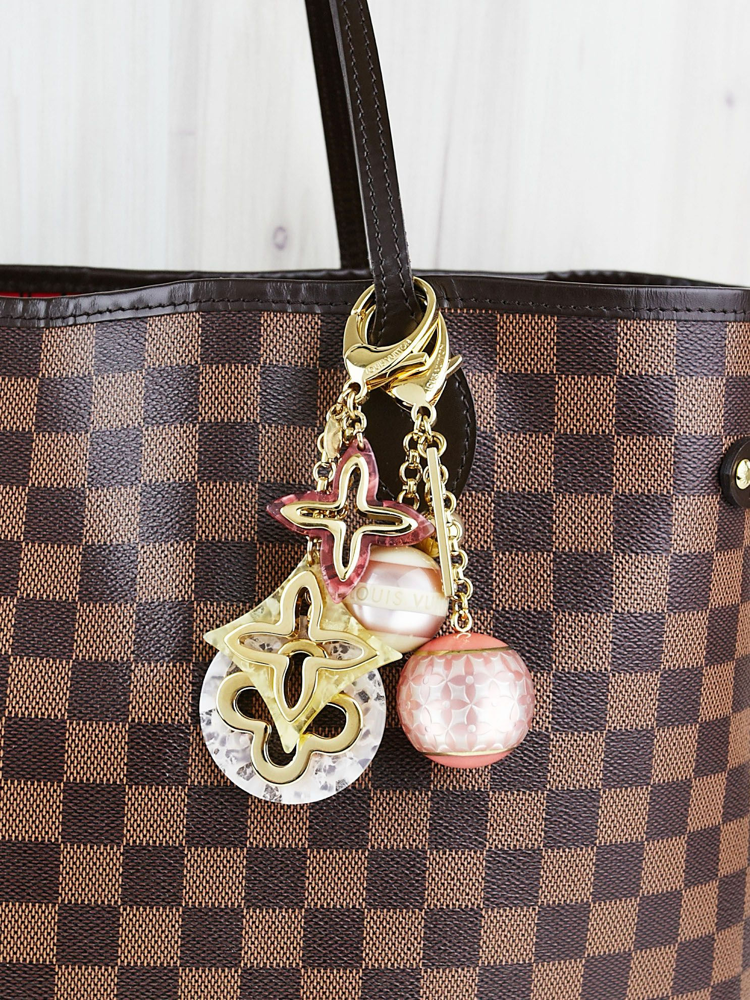 LV Bag Charms are the perfect way to add a little flare to your bags! -  Yoogi s Closet 4e2bc241a5410