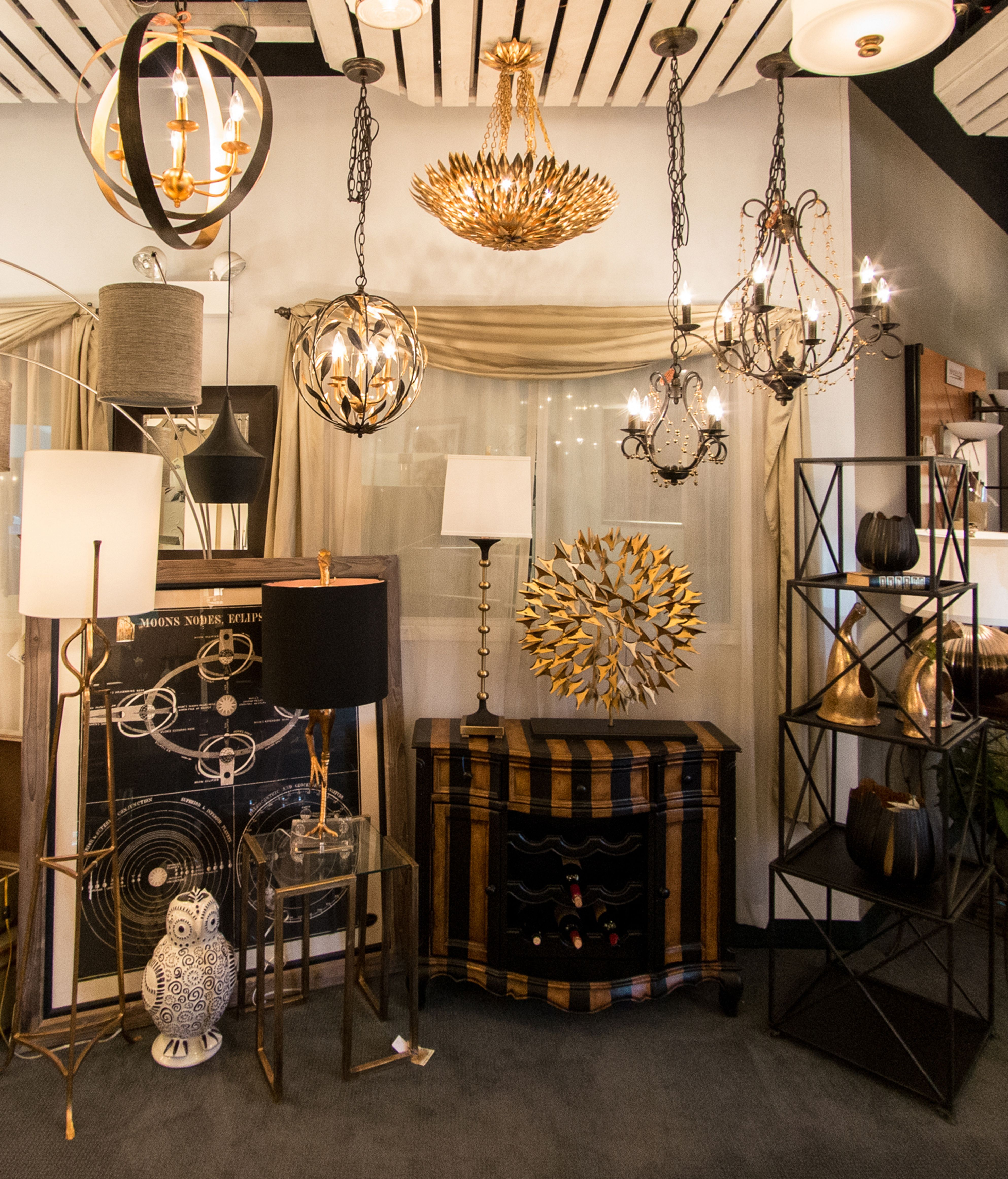 Elcectic Display Of Bronze And Gold Chandeliers Decor