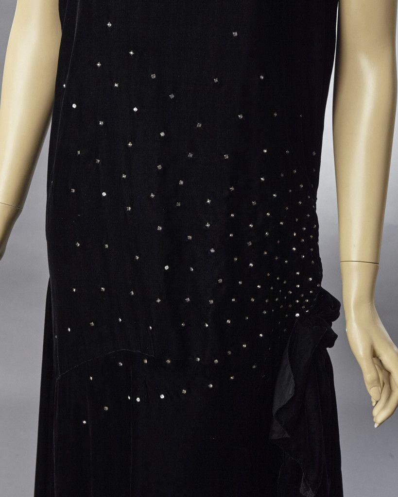 S dramatic black silk velvet evening dress decorated in