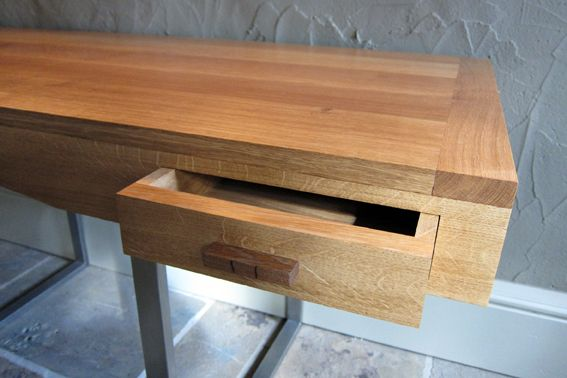 A bespoke contemporary desk made of of oak with stainless steel legs www.davidtowers.biz