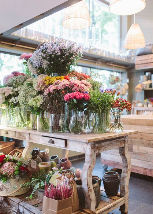 Foto interior y exterior tienda florist flower shop for Foto interior design