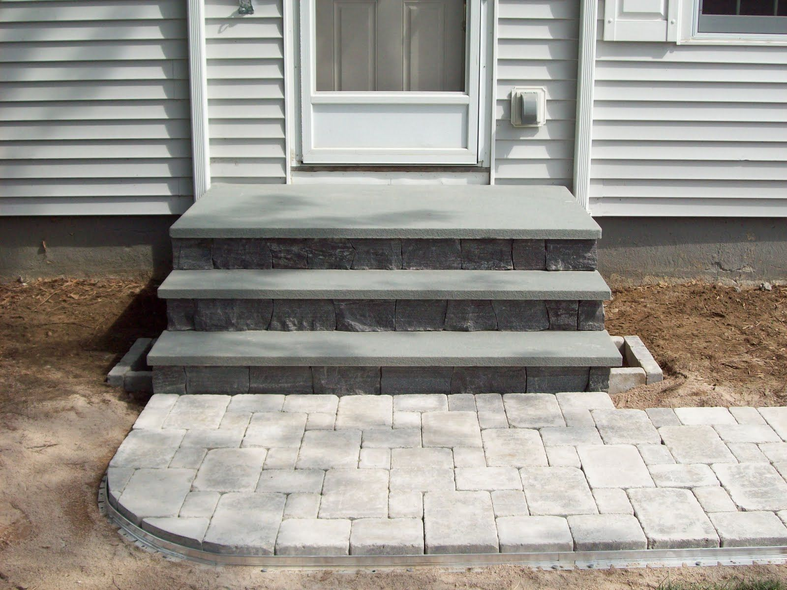 How to build steps with pavers - Back Porch Landing Ideas Steps Plantings And Brussels Block Paver Walk To Driveway