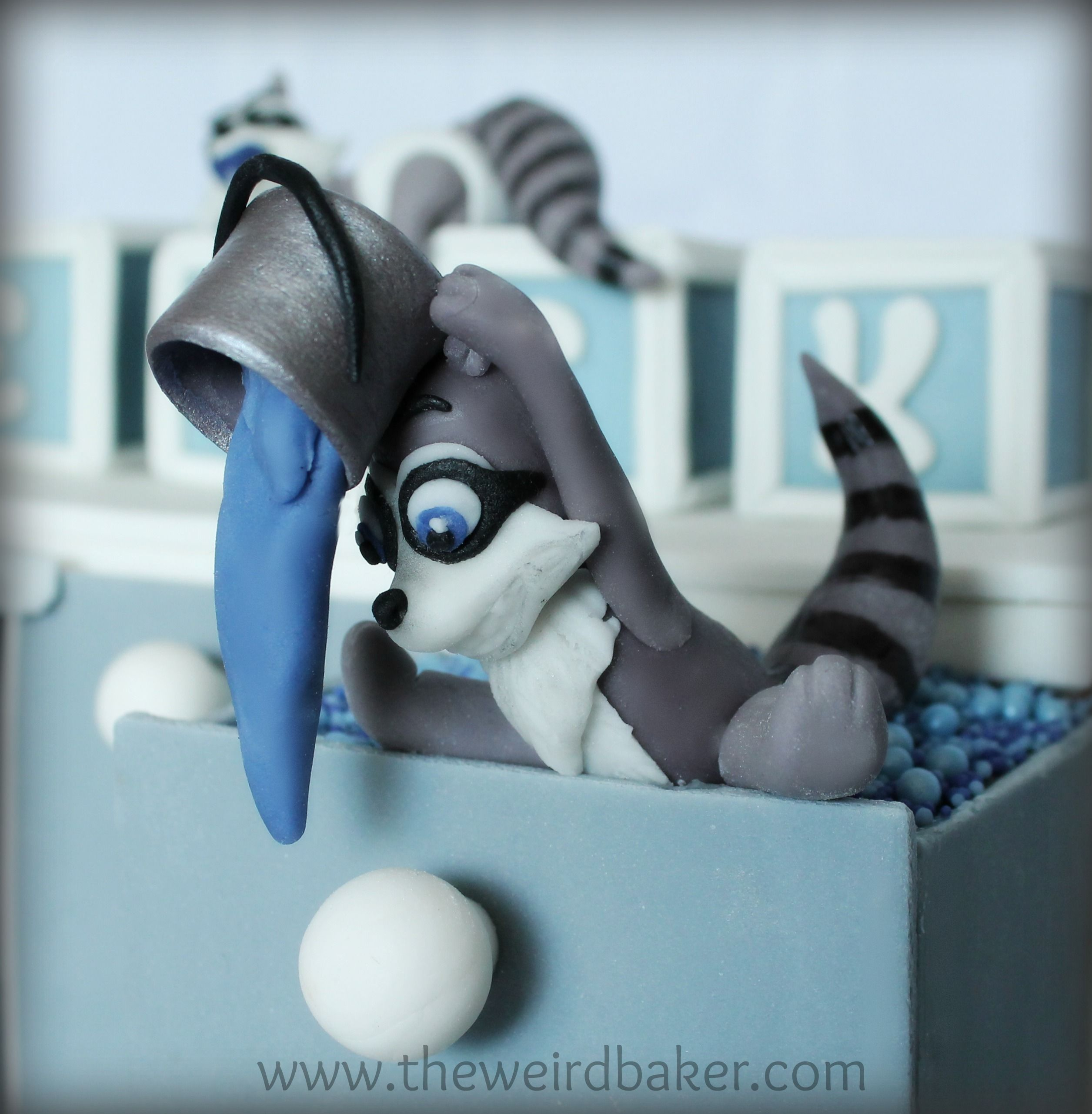 Fondant raccoon being naughty!
