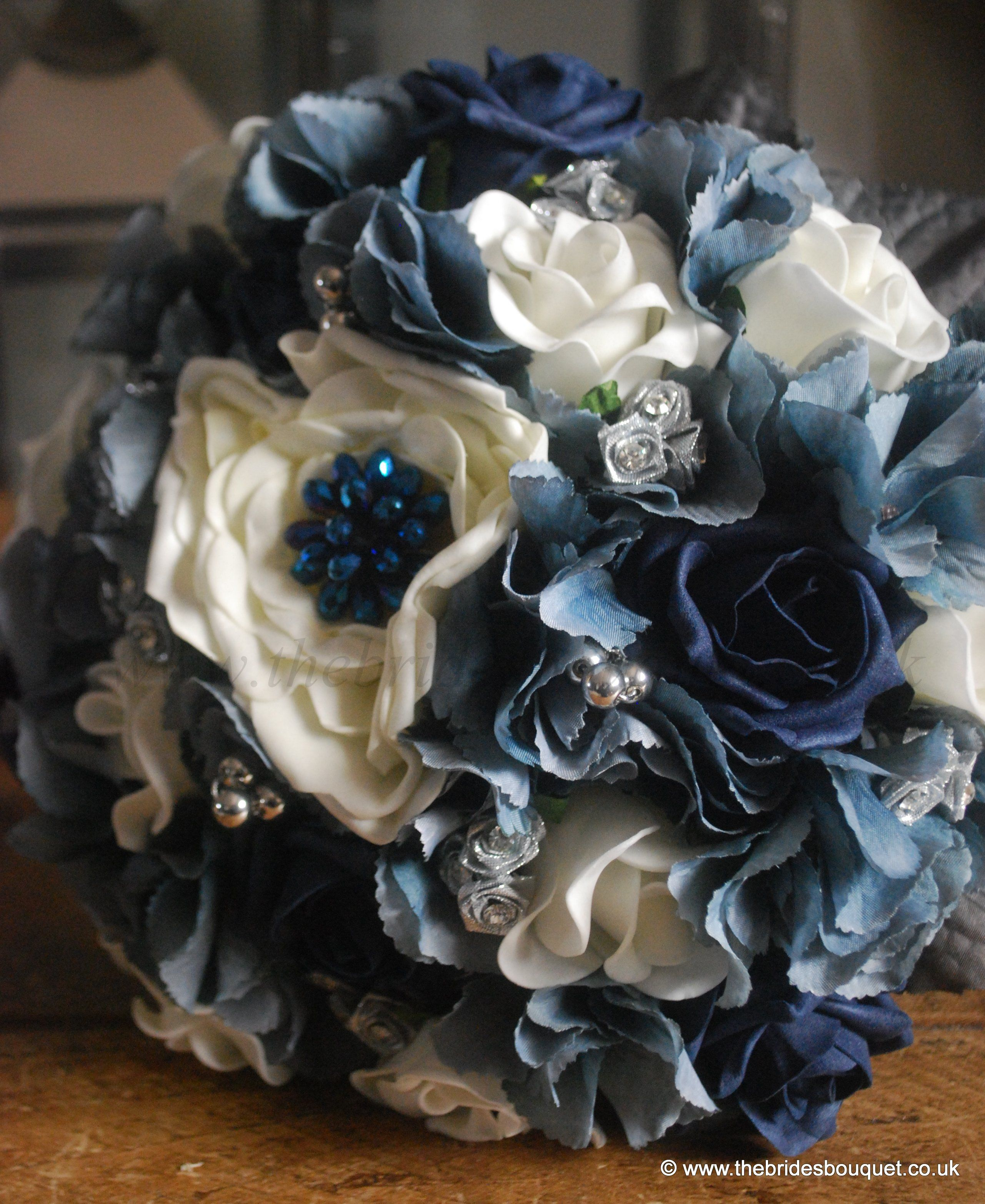 Winter Wedding, bridal bouquet. Silvery blue wedding flowers, navy rose with hydrangea and jewels. more silver and add silver pine cones....