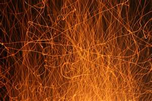 picture of sparks coming from a camp fire_