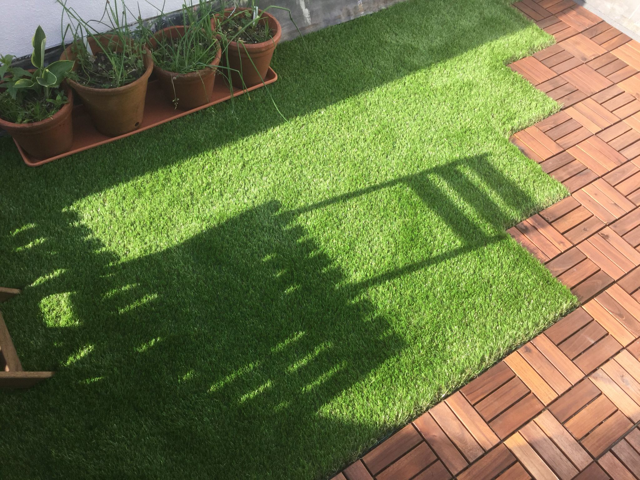 Roof terrace with ikea tiles and Oakham artificial grass 2