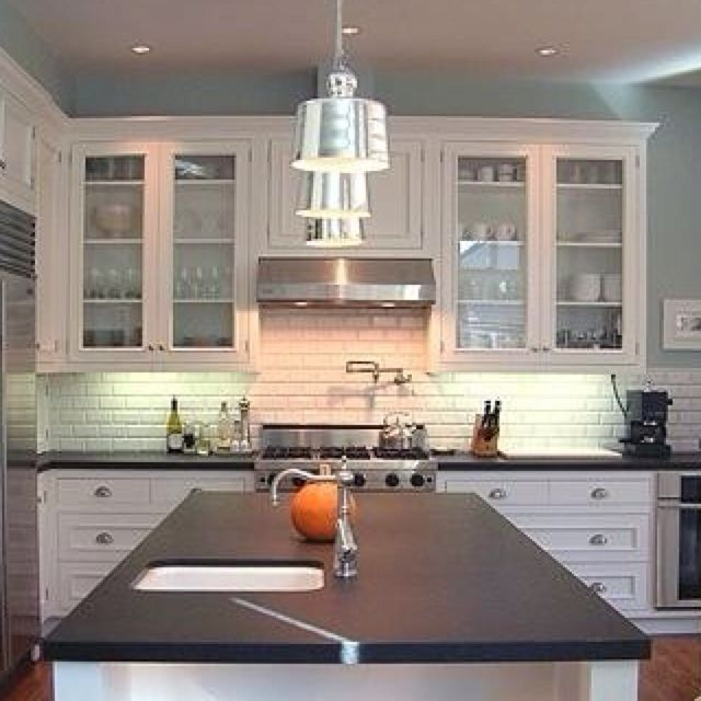 Kitchen Backsplash With Black Granite Countertops And White Cabinets: White Cabinets, Black Countertops, Wood Floors 2