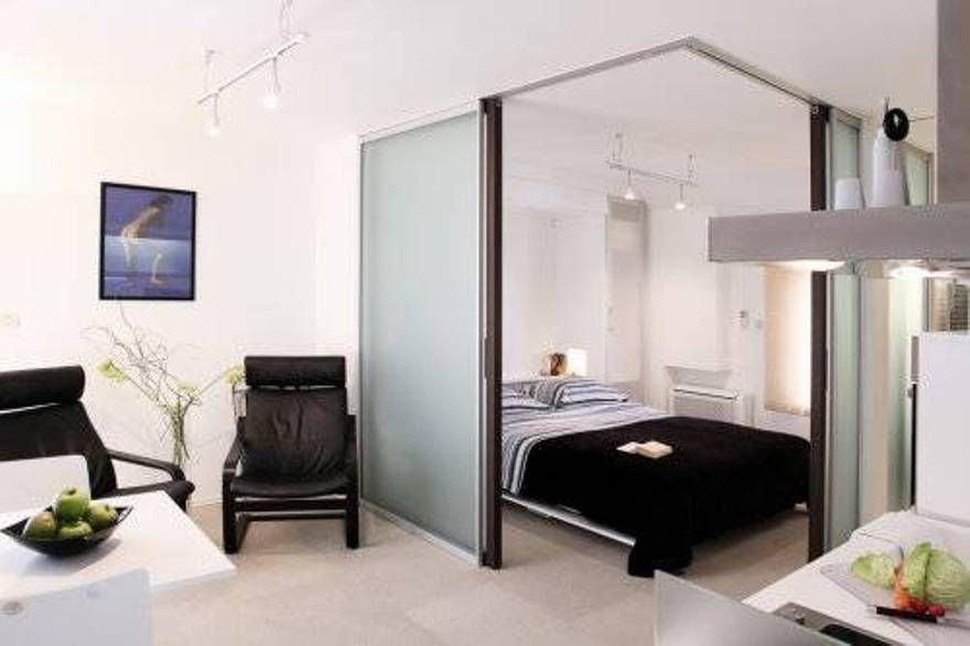 Studio Apartment Furniture With Black Chairs And Bed With Frosted