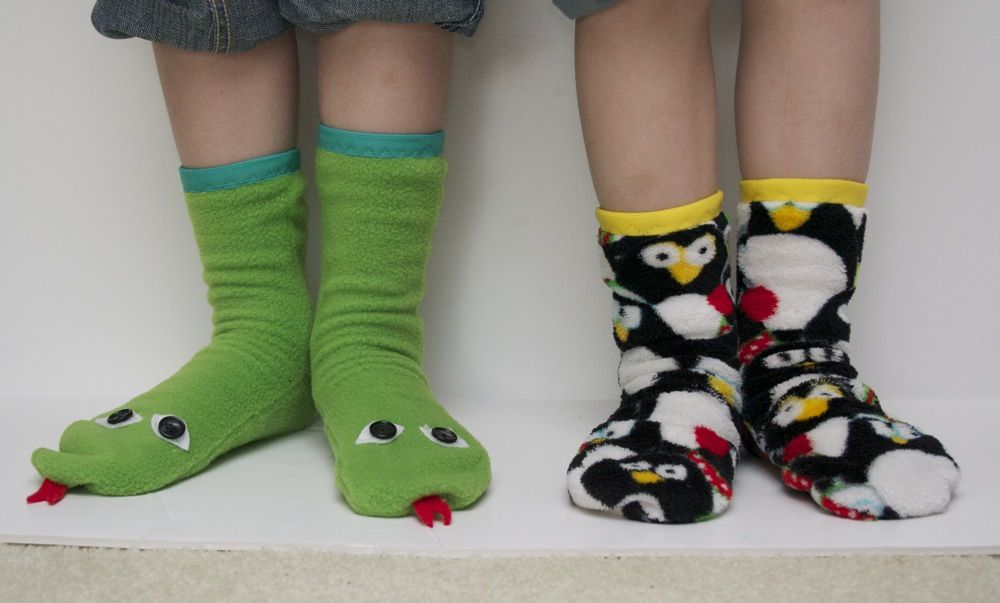 Sew Can Do: Slipper Socks Pattern Review & Helpful Hints  I found this free pdf pattern for socks though I have not tried it yet: https://docs.google.com/viewer?a=v=cache:0ZzDyUeYhFEJ:www.cedesign.com/familyphotos/sewing/holidays/fleecebooties.pdf+=fr=ca=bl=ADGEESgoppe2kgFH6aO6j6XpLqsIgNzZNwfl8fun4uDXK3cF4Ymk7lGKaFux3vzNAH7TZBBoWJHYNFLX136pyMU8hOPZq_9_itj7jSpgmoH7gdtUrPP5X_tjkEUxq6WhyZQMc7kUs1Wv=AHIEtbRbPvGPJVq-fQV_Hrh-Uqa01iWHeA