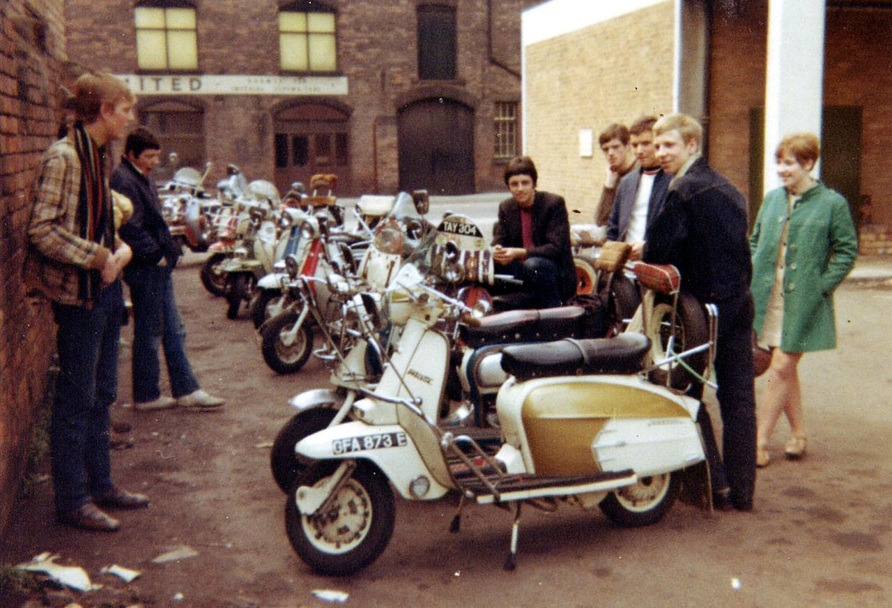 1960s comic swinging with scooter