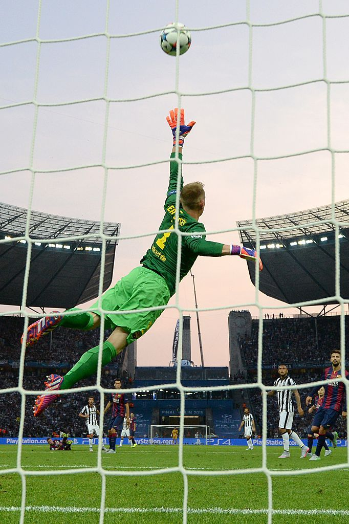 Barcelona's German goalkeeper Marc-Andre ter Stegen jumps to save a goal during the UEFA Champions League Final football match between Juventus Torino and FC Barcelona at the Olympic Stadium in Berlin on June 6, 2015.  AFP PHOTO / PATRIK STOLLARZ        (Photo credit should read PATRIK STOLLARZ/AFP/Getty Images)