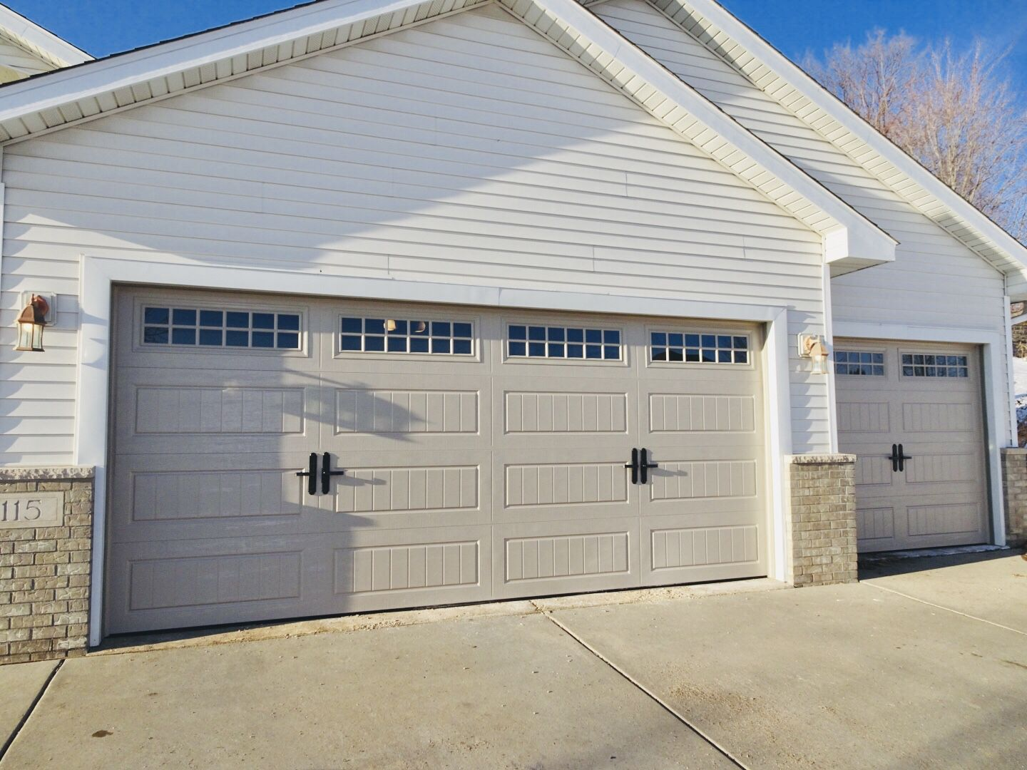 Amarr Hillcrest 3000 Garage Door In Sandtone Carriage House Doors Garage Door Styles Garage Door Types