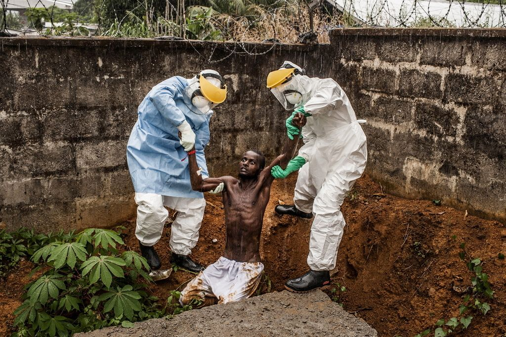 World's best press photographies - Personal from Hastings Ebola Treatment Center in Freetown, Sierra Leone, bring back a man with Ebola back the the isolation center after he tried to escape.