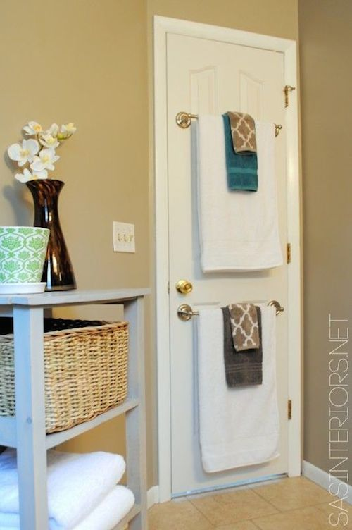 Use the back of a bathroom door to hang towels! | 29 Sneaky Tips For Small Space Living More & 29 Sneaky DIY Small Space Storage and Organization Ideas (on a ...