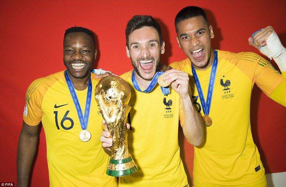 2350f186916 Goalkeeper s union  Lloris parades the trophy while Steve Mandanda and Alphonse  Areola che.