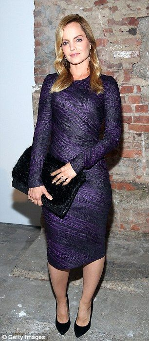 Mena Suvari wore a long sleeved purple dress and oversized clutch for the Christian Siriano show at #NYFW http://dailym.ai/1tmeCGR
