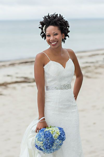 Show off the natural texture you were born with, like this stunning beachside bride.