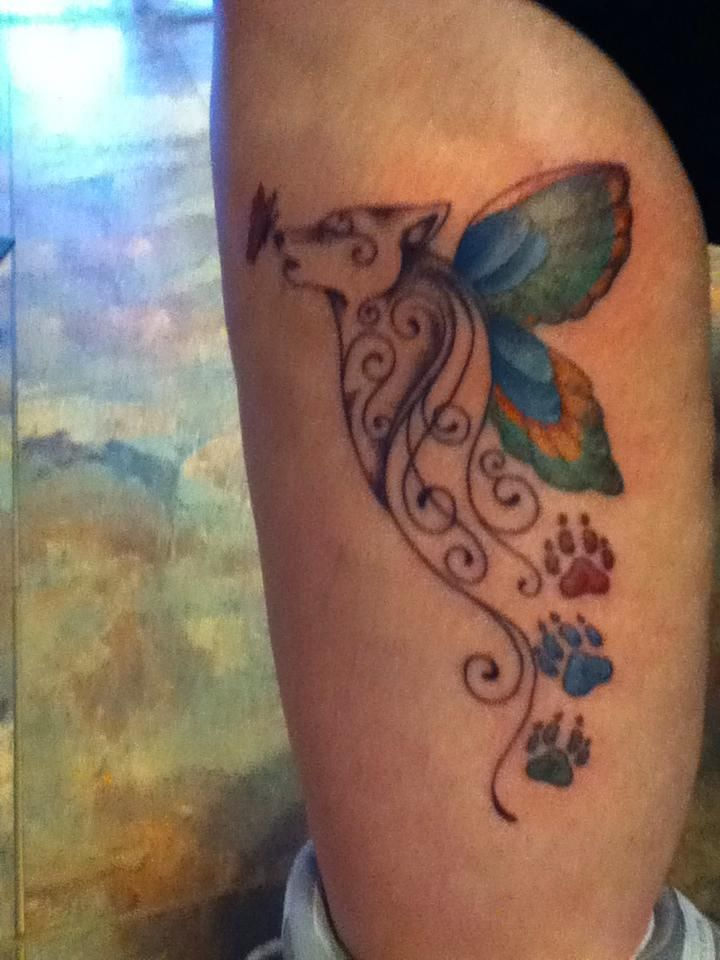 101773180 Butterfly wolf tattoo I could do this and do the kiddos names by the paw  prints