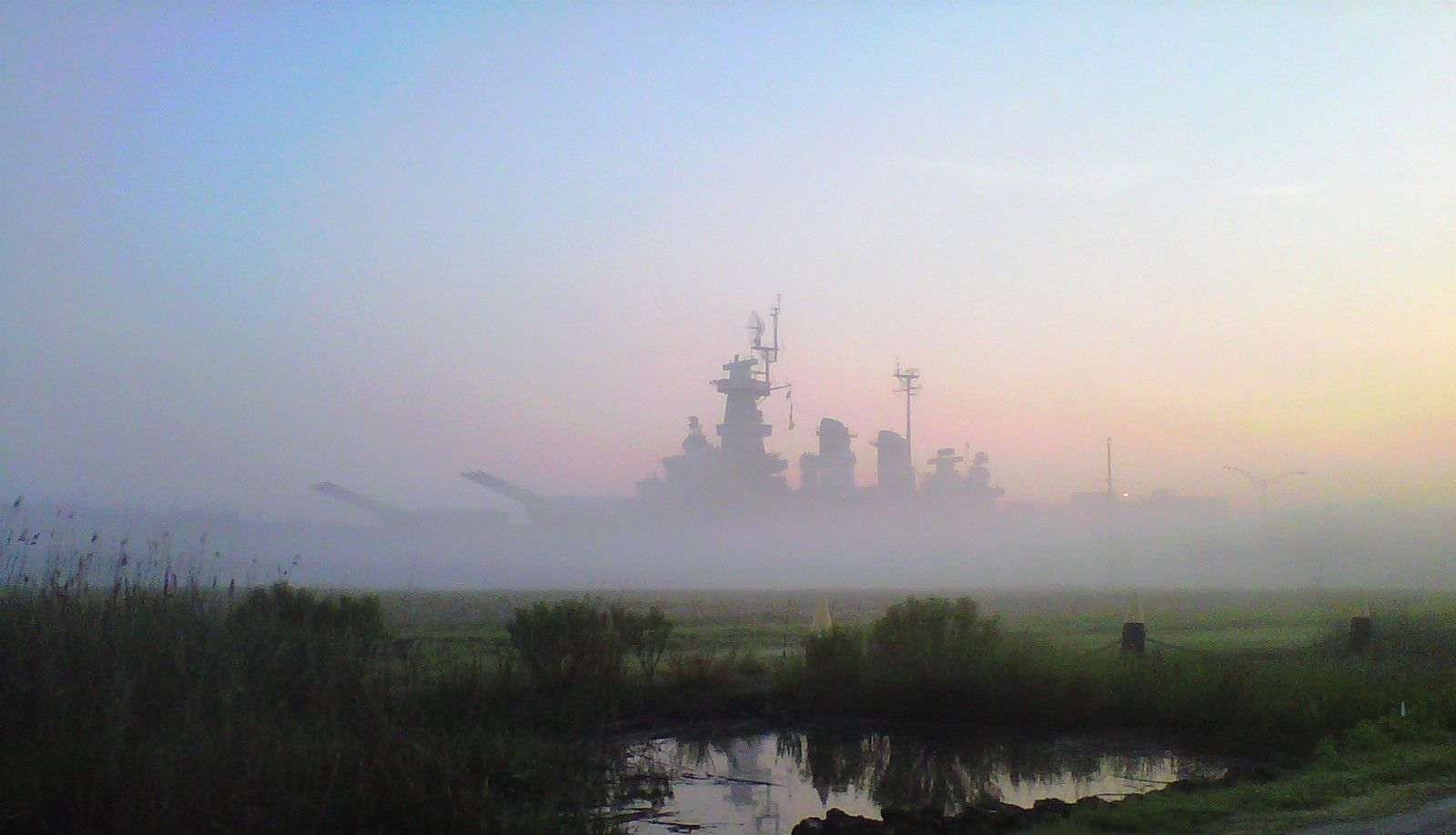 USS North Carolina (BB-55) at first light