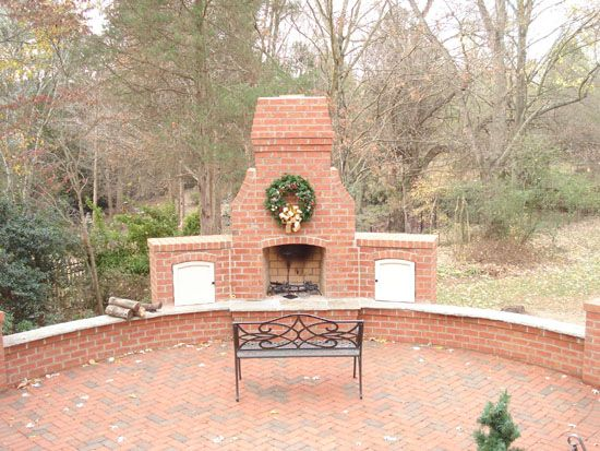 Outdoor Brick Fireplace With Ledge For Seating