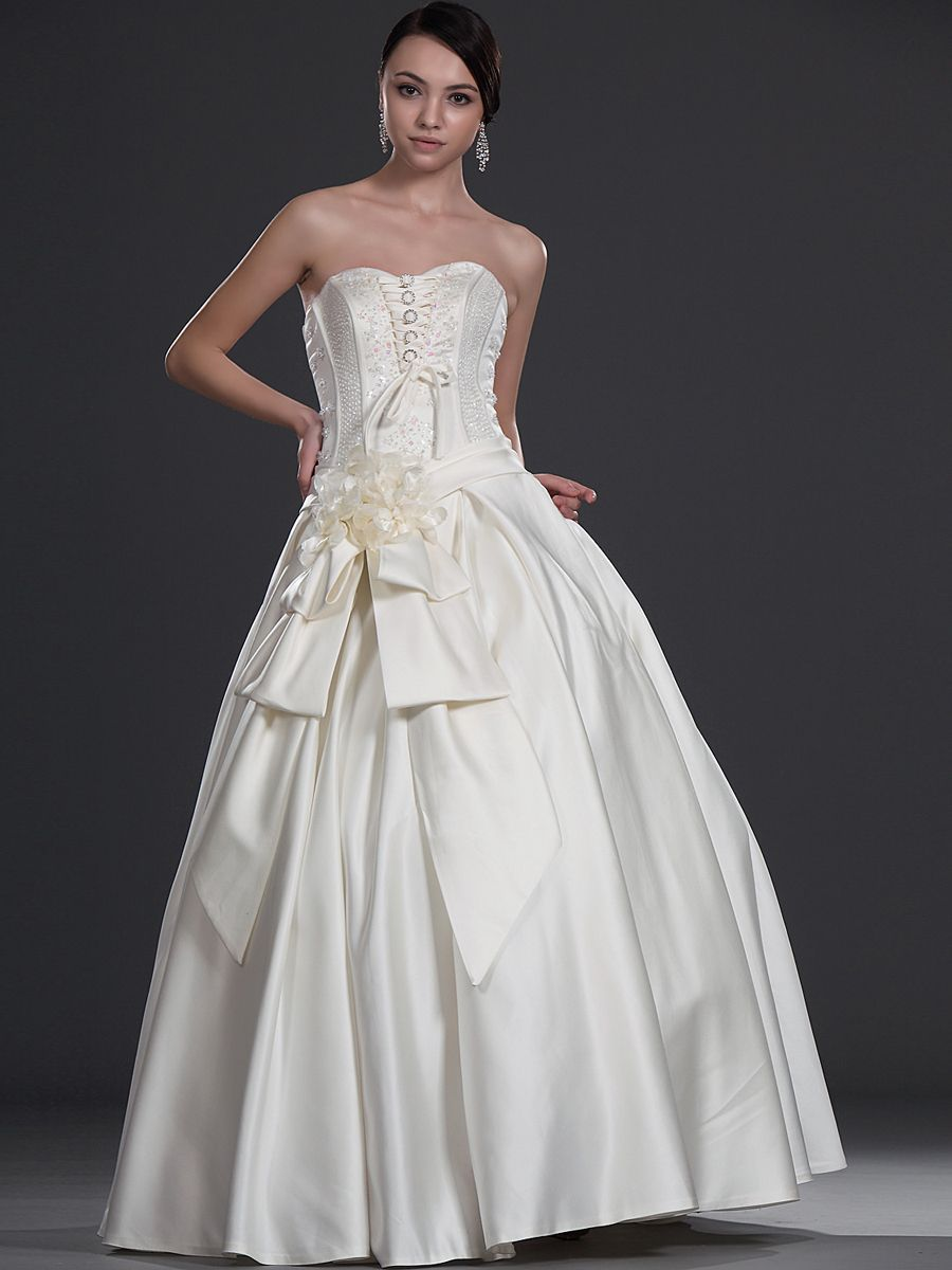 Beaded strapless full satin ball gown with oversized bow