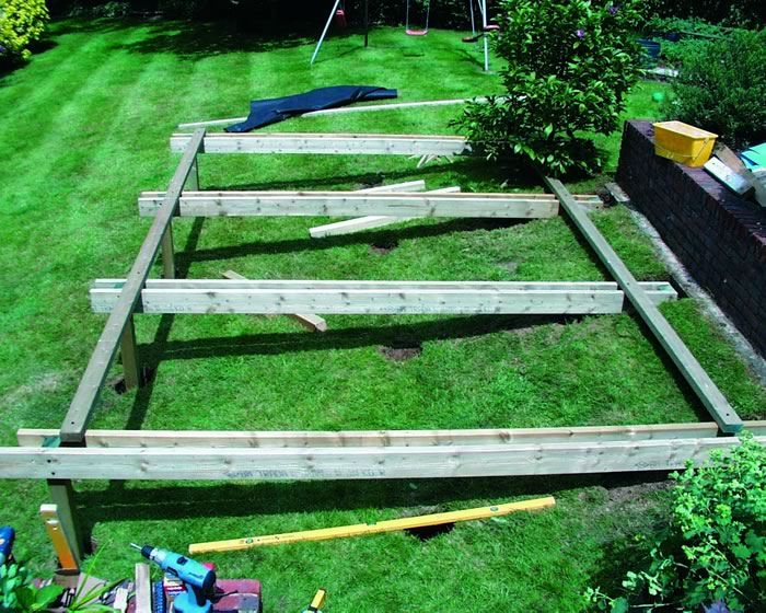 decking built into a sloping bank | The Man shop and shed ...